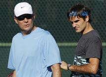 Roger Federer (R) of Switzerland walks on a practice court with coach Paul Annacone (L) during a workout while preparing for the Indian Wells ATP tennis tournament in Indian Wells, California, March 8, 2012. REUTERS/Danny Moloshok
