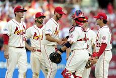 Oct 12, 2013; St. Louis, MO, USA; St. Louis Cardinals manager Mike Matheny (middle) is congratulated by catcher Yadier Molina (4) as he is relived by manager Mike Matheny (22) during the seventh inning against the Los Angeles Dodgers in game two of the National League Championship Series baseball game at Busch Stadium. Mandatory Credit: Jeff Curry-USA TODAY Sports