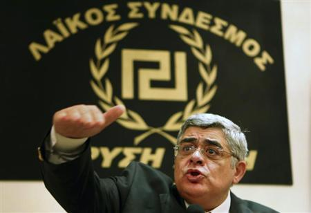 Leader of extreme-right Golden Dawn party Nikolaos Mihaloliakos (C) talks to reporters at a news conference in Athens May 6, 2012. REUTERS/Yannis Behrakis