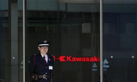 A security guard stands in front of the logo of Kawasaki Heavy Industries, Ltd. at the company's Tokyo Head Office in Tokyo April 22, 2013. REUTERS/Toru Hanai