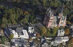 An aerial view shows Limburg cathedral (R) and to the left the ensemble of the bishop of Limburg's residence along the river Lahn October 14, 2013. REUTERS/Wolfgang Rattay