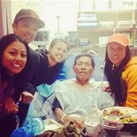 Gene Penaflor (C) is pictured in the hospital surrounded by family members in this undated handout photo courtesy of the Penaflor family via Instagram. Penaflor, a 72-year-old California deer hunter, was recovering October 14, 2013 after surviving on squirrels and packing leaves around him for warmth for nearly three weeks while he was lost and alone in the snowy wilderness, authorities said. REUTERS/Penaflor Family/Handout via Reuters
