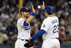 October 14, 2013; Los Angeles, CA, USA; Los Angeles Dodgers center fielder Andre Ethier (16) and first baseman Adrian Gonzalez (23) celebrate the 3-0 victory against the St. Louis Cardinals following game three of the National League Championship Series baseball game at Dodger Stadium. Jayne Kamin-Oncea-USA TODAY Sports