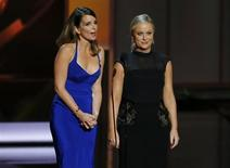 Actresses Tina Fey (L) and Amy Poehler present the award for Outstanding Supporting Actress In A Comedy Series at the 65th Primetime Emmy Awards in Los Angeles September 22, 2013. REUTERS/Mike Blake