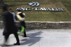 Pedestrians walk past a sign for the head office of SNC Lavalin in downtown Montreal March 26, 2012.REUTERS/Christinne Muschi