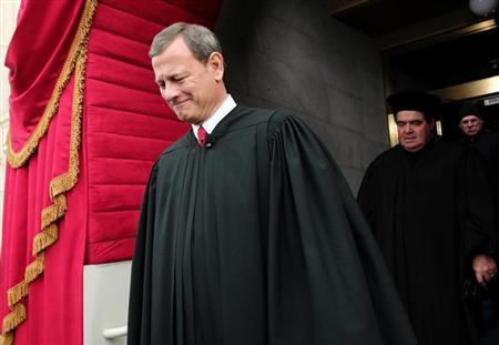 Supreme Court Chief Justice John Roberts is followed by Supreme Court Justice Antonin Scalia as they arrive for the presidential inauguration on the West Front of the U.S. Capitol in Washington January 21, 2013. REUTERS/Win McNamee/Pool