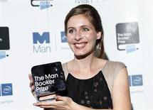New Zealand writer Eleanor Catton, winner of the Man Booker Prize 2013, poses for photographs at the Guildhall in central London, October 15, 2013. REUTERS/Olivia Harris