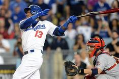 October 14, 2013; Los Angeles, CA, USA; Los Angeles Dodgers shortstop Hanley Ramirez (13) hits an RBI single in the eighth inning against the St. Louis Cardinals in game three of the National League Championship Series baseball game at Dodger Stadium. Jayne Kamin-Oncea-USA TODAY Sports