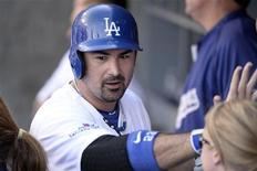 October 16, 2013; Los Angeles, CA, USA; Los Angeles Dodgers first baseman Adrian Gonzalez (23) reacts after hitting a solo home run in the eighth inning against the St. Louis Cardinals in game five of the National League Championship Series baseball game at Dodger Stadium. Richard Mackson-USA TODAY Sports