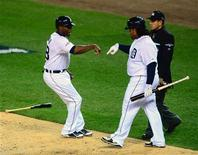 Oct 16, 2013; Detroit, MI, USA; Detroit Tigers right fielder Torii Hunter (48) celebrates with first baseman Prince Fielder (28) after scoring against the Boston Red Sox during the second inning in game four of the American League Championship Series baseball game at Comerica Park. Andrew Weber-USA TODAY Sports