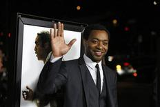 "Cast member Chiwetel Ejiofor waves at a special screening of ""12 Years a Slave"" at the Directors Guild of America in Los Angeles, California in this file photo taken October 14, 2013. REUTERS/Mario Anzuoni/Files"