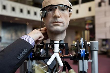 An engineer makes an adjustment to the robot ''The Incredible Bionic Man'' at the Smithsonian National Air and Space Museum in Washington October 17, 2013. REUTERS/Joshua Roberts