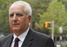 Former Bernard L. Madoff Investment Securities operations officer Daniel Bonventre departs Manhattan Federal Court in New York in this file photo taken August 9, 2013. REUTERS/Brendan McDermid/Files