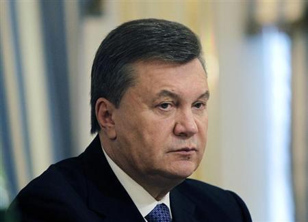 Ukrainian President Viktor Yanukovich is seen during his meeting with European Commissioner for Enlargement and European Neighbourhood Policy Stefan Fule in Kiev October 11, 2013. REUTERS/Sergei Chuzavkov/Pool