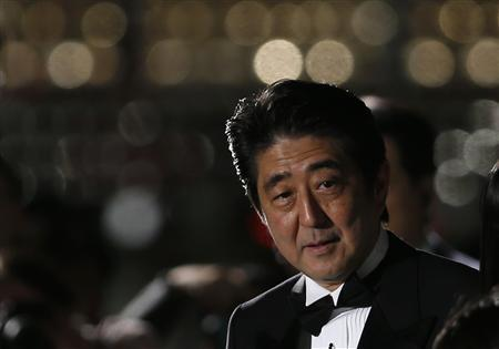 Japan's Prime Minister Shinzo Abe attends the opening event of the Tokyo International Film Festival in Tokyo October 17, 2013. REUTERS/Toru Hanai