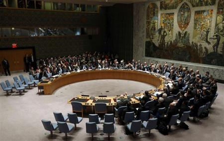 Members of the United Nations Security Council raise their hands as they vote unanimously to approve a resolution eradicating Syria's chemical arsenal during a Security Council meeting during the 68th United Nations General Assembly in New York on September 27, 2013. REUTERS/Adrees Latif