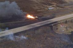 A train derailment in Gainford, Alberta is seen in this aerial photo courtesy of the RCMP and Parkland County, October 19, 2013. REUTERS/RCMP and Parkland County/Handout