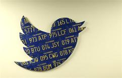 A Twitter logo made from Californian license plates is shown at the company's headquarters in San Francisco, California October 4, 2013. REUTERS/Robert Galbraith