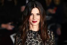 """Actress Sandra Bullock arrives at a gala screening of her film """"Gravity"""" at the London Film Festival at a cinema in Leicester Square, central London, October 10, 2013. REUTERS/Andrew Winning"""
