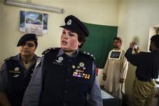Pakistani Police Inspector Shazadi Gillani (C) talks to a member of her team at a police station in Abbottabad September 18, 2013. REUTERS/Zohra Bensemra