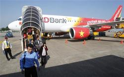 Vietjet Air passengers exit the aircraft after arriving at Tan Son Nhat airport in Vietnam's southern Ho Chi Minh city October 20, 2013. REUTERS/Kham