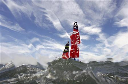 The Team Emirates New Zealand sails before the third race of their Louis Vuitton Cup challenger series yacht race against Luna Rossa Challenge in this underwater picture in San Francisco, California August 18, 2013. REUTERS/Peter Andrews