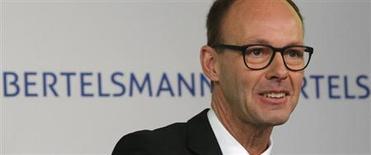 Thomas Rabe, président du directoire de Bertelsmann. Le géant des médias allemand vise un chiffre d'affaires de 20 milliards d'euros d'ici 2016 ou 2017. /Photo prise le 26 mars 2013/REUTERS/Tobias Schwarz