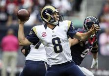 Oct 13, 2013; Houston, TX, USA; St. Louis Rams quarterback Sam Bradford (8) attempts a pass during the second quarter against the Houston Texans at Reliant Stadium. Troy Taormina-USA TODAY Sports