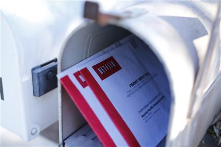 Netflix DVDs return mailers are shown in a mail box in Encinitas, California October 21, 2013. REUTERS/Mike Blake