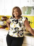 Celebrity chef Sunny Anderson is shown in this undated handout photo taken in her kitchen in Brooklyn, New York and provided by Clarkson Potter on October 21, 2013. REUTERS/John Lee/Clarkson Potter/Handout via Reuters