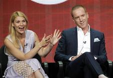 "Cast member Claire Danes gestures next to co-star Damian Lewis at a panel for the television series ""Homeland"" during the Showtime portion of the Television Critics Association Summer press tour in Beverly Hills, California July 29, 2013. REUTERS/Mario Anzuoni"