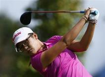 Lydia Ko of New Zealand tees off on the seventh hole during the third and final round of the women's Evian Championship golf tournament in Evian September 15, 2013. REUTERS/Denis Balibouse