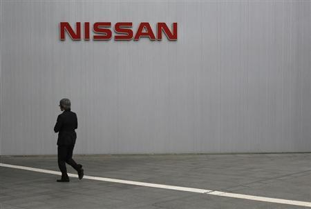 A visitor walks toward to the entrance of Nissan Motor Co's global headquarters in Yokohama, south of Tokyo May 10, 2013. REUTERS/Toru Hanai