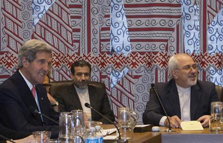 U.S. Secretary of State John Kerry (L) and Iran's Foreign Minister Mohammad Javad Zarif (R) are seated during a meeting of the foreign ministers representing the permanent five member countries of the United Nations Security Council, including Germany, at UN Headquarters in New York September 26, 2013. REUTERS/Brendan McDermid