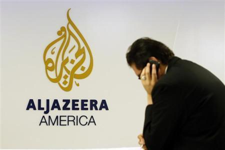 A man works at a desk in the Al Jazeera America broadcast center in New York, August 20, 2013. REUTERS/Brendan McDermid