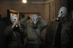 Members of the Hoppmann family wear gas masks during the 'reality event' one night at the 'Bunker-Museum' in Rennsteighoehe near the eastern city of Ilmenau October 12, 2013. REUTERS/Ina Fassbender