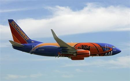 A Southwest Airlines passenger aircraft painted with a new NBA logo theme arrives at Love Field airport for a news conference in Dallas, Texas, November 3, 2005.