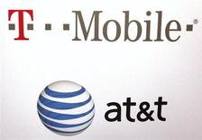 AT & T and T-Mobile logos are seen posted on the wall of a subway station at West 14th street and 8th avenue in New York September 27, 2011. REUTERS/Shannon Stapleton