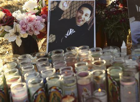 A photo of Andy Lopez Cruz is shown at a makeshift memorial at the site of his death in Santa Rosa, California October 24, 2013. REUTERS/Robert Galbraith