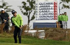 Luke Guthrie of the U.S. plays a shot on the 8th hole during the BMW Masters 2013 golf tournament at Lake Malaren Golf Club in Shanghai October 26, 2013. REUTERS/Carlos Barria