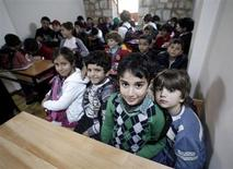 Syrian refugee children attend class at a school for refugee children in Istanbul October 21, 2013. REUTERS/Osman Orsal