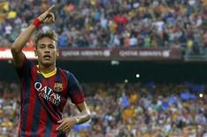 """Barcelona's Neymar celebrates after scoring a goal against Real Madrid during their Spanish first division """"Clasico"""" soccer match at Nou Camp stadium in Barcelona October 26, 2013. REUTERS/Albert Gea"""