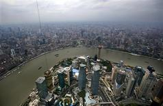 A general view of Shanghai's financial district of Pudong is seen from the top of the Shanghai Tower, which is undergoing construction, August 2, 2013. REUTERS/Carlos Barria