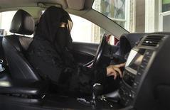 A woman drives a car in Saudi Arabia October 22, 2013. REUTERS/Faisal Al Nasser