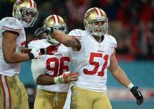 San Francisco 49ers outside linebacker Dan Skuta (51) celebrates with teammates including Corey Lemonier (96) after scoring a touchdown on a fumble recovery return against the Jacksonville Jaguars in the second half during an International Series game at Wembley Stadium. Mandatory Credit: Bob Martin-USA TODAY Sports