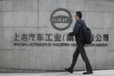 A man walks in front of the gate of Shanghai Automotive Industry Corp. in Shanghai November 18, 2010. REUTERS/Aly Song