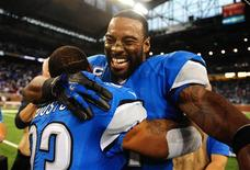 Detroit Lions wide receiver Calvin Johnson (81) celebrates with cornerback Chris Houston (23) after defeating the Dallas Cowboys 31-30 at Ford Field. Mandatory Credit: Andrew Weber-USA TODAY Sports