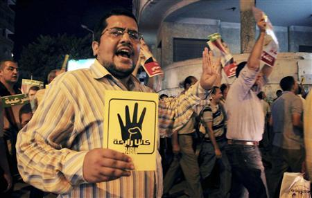 Muslim Brotherhood supporter Ahmed Nabil shouts slogans during a demonstration in Alexandria, 230 km (143 miles) north of Cairo, September 4, 2013. REUTERS-Stringer-