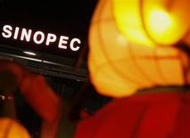 A Sinopec sign displayed at its gas station is seen behind a Chinese New Year lantern installation in Hong Kong February 5, 2013. REUTERS/Bobby Yip