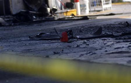 A gas pump lies on the ground following an arson attack at a gas station in Morelia October 27, 2013. REUTERS/Alan Ortega